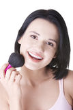 Woman doing make-up on face. Attractive woman doing make-up on face Stock Images