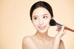 Woman doing make up on face with cosmetic brush Royalty Free Stock Photos