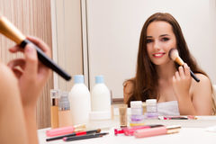 The woman doing make-up at home preparing for party Royalty Free Stock Image