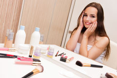 The woman doing make-up at home preparing for party Royalty Free Stock Photography