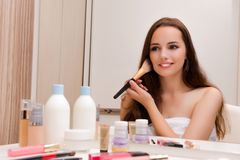 The woman doing make-up at home preparing for party Royalty Free Stock Photo