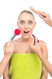 Woman doing make up with many hands and arms helping her get the job done faster. Royalty Free Stock Photos