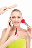 Woman doing make up with many hands and arms helping her get the job done faster. Stock Photos