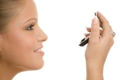 Woman doing makeup Royalty Free Stock Photo