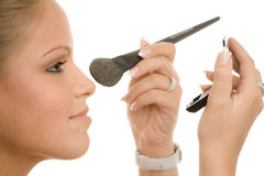 Woman doing makeup Stock Image