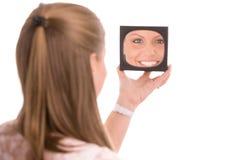 Woman doing makeup Royalty Free Stock Photography