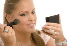 Woman doing makeup Stock Images