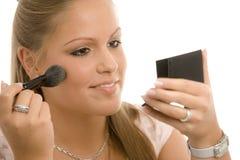 Woman doing makeup Stock Images