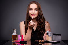 The woman doing makeup on dark background Stock Images