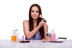 The woman doing makeup isolated on white Royalty Free Stock Images