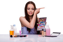 The woman doing makeup isolated on white Stock Photography