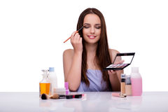 The woman doing makeup isolated on white Stock Images