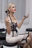 Woman doing makeup Royalty Free Stock Image