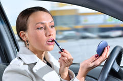 Woman is doing makeup on the run Royalty Free Stock Images