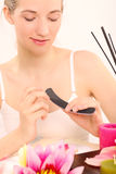 Woman doing manicure Stock Photography