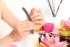 Woman doing manicure Royalty Free Stock Photos