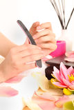 Woman doing manicure Royalty Free Stock Photo