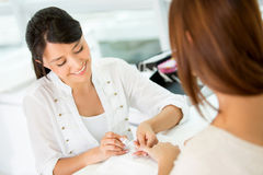 Woman doing a manicure Stock Images