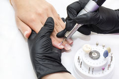 Woman doing manicure Royalty Free Stock Images