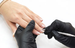 Woman doing manicure Royalty Free Stock Photography