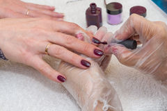 Woman doing manicure in beauty salon close-up Royalty Free Stock Images