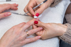 Woman doing manicure in beauty salon close-up Stock Photos