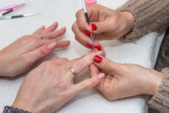 Woman doing manicure in beauty salon close-up Royalty Free Stock Image