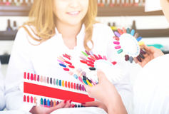 Woman doing manicure Royalty Free Stock Image