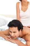 Woman doing a massage to her boyfriend Stock Photos