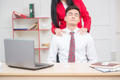 Woman doing massage to her colleague in office, Stock Photos