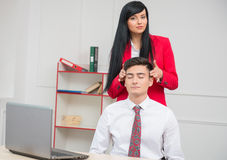 Woman doing massage to her colleague in office Royalty Free Stock Photo