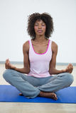 Woman doing meditation on exercise mat Stock Photo