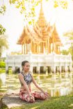 Woman doing meditation in lotus pose near temple. royalty free stock images