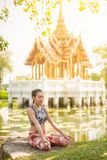 Woman doing meditation in lotus pose near temple. stock photography