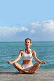 Woman doing meditation and yoga Royalty Free Stock Photo