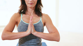 Woman doing meditation yoga in gym Royalty Free Stock Images
