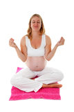 Woman doing meditative pregnancy yoga Royalty Free Stock Photos