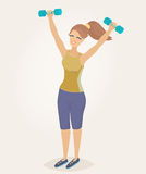 A woman doing morning exercises. A woman with auburn hair doing morning exercises with dumbbells Stock Photo