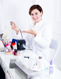 Woman doing nails displaying her workplace Royalty Free Stock Images