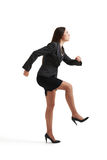 Woman doing one step and looking up Stock Photo