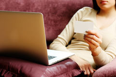 Woman doing online shopping with blank credit card Stock Images