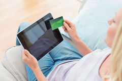 Woman doing online shopping on digital tablet at home Royalty Free Stock Photography