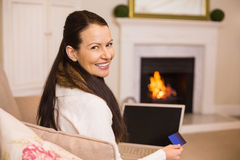Woman doing online shopping with laptop and credit card Stock Photography