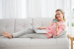 Woman doing online shopping with laptop and credit card Royalty Free Stock Photo