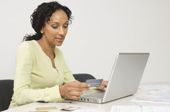 Woman Doing an Online Transaction Stock Photos