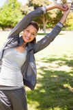 Woman doing overhead stretches Royalty Free Stock Photo