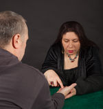 A woman is doing a palm reading. A dark dressed women is doing a palm reading stock images