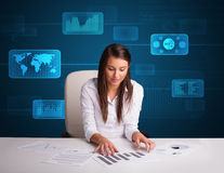 Woman doing paperwork with futuristic digital backgroung Royalty Free Stock Photos