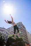 Woman doing parkour in the city Royalty Free Stock Images
