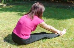 Woman doing physical exercises Stock Photos